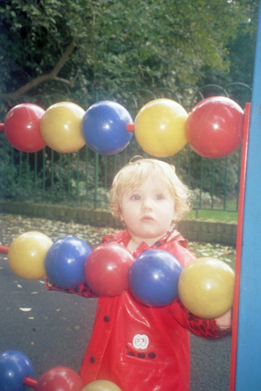 Grace in a playground aged one